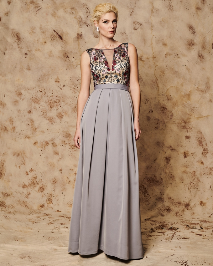 Long evening dress with applique flowers and beading