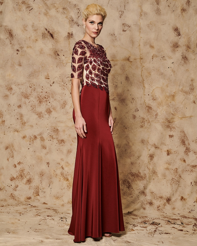 Long evening dress with tulle sleeves and beading