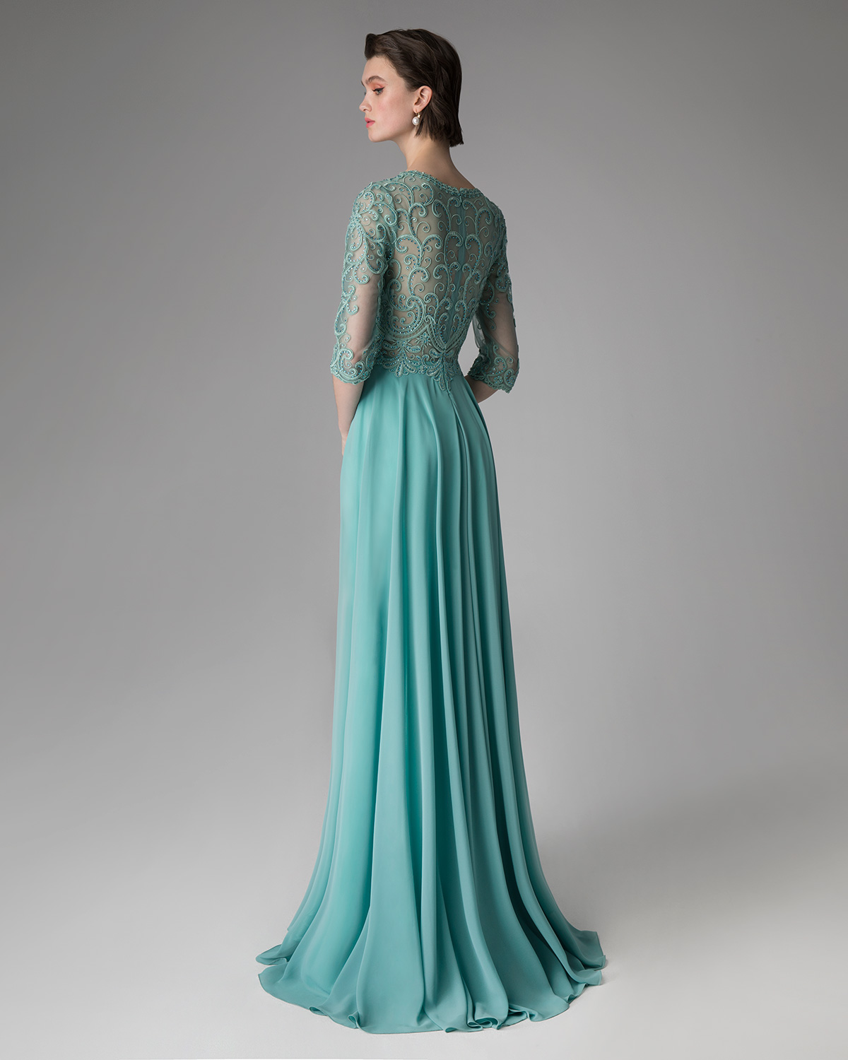 Long evening dress with applique lace on the top and long sleeves