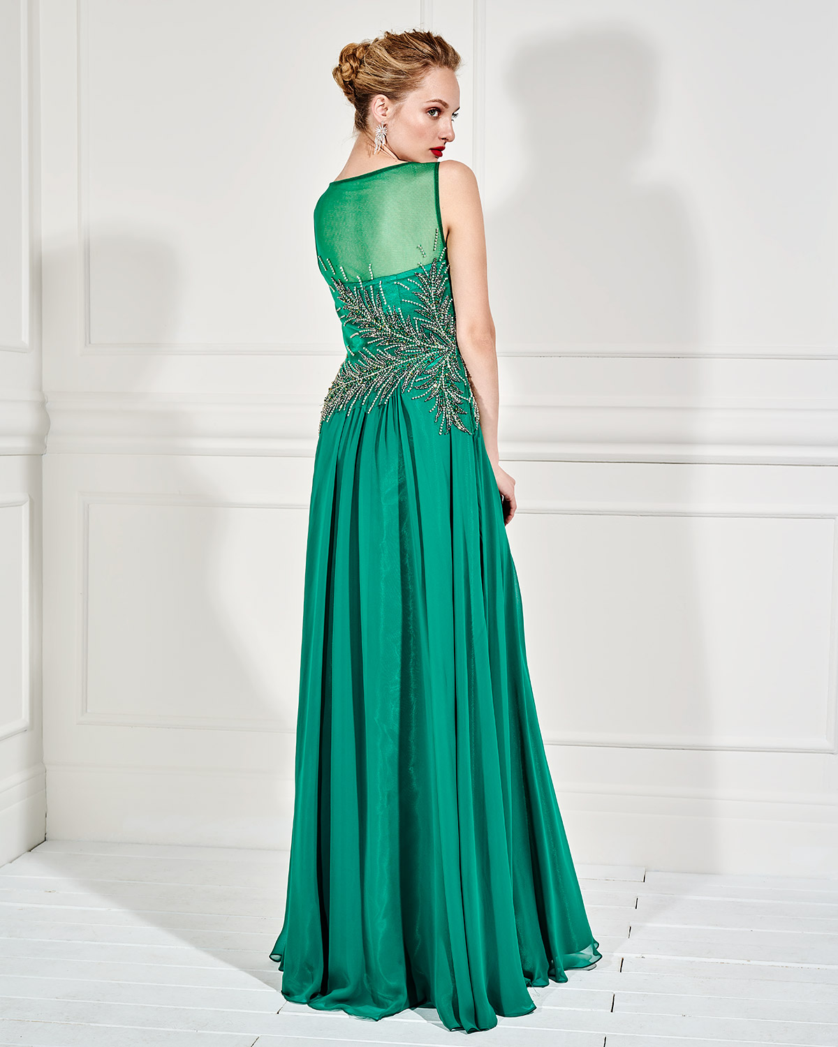 Evening Dresses / Long evening dress with beaded bust and transparency on the back