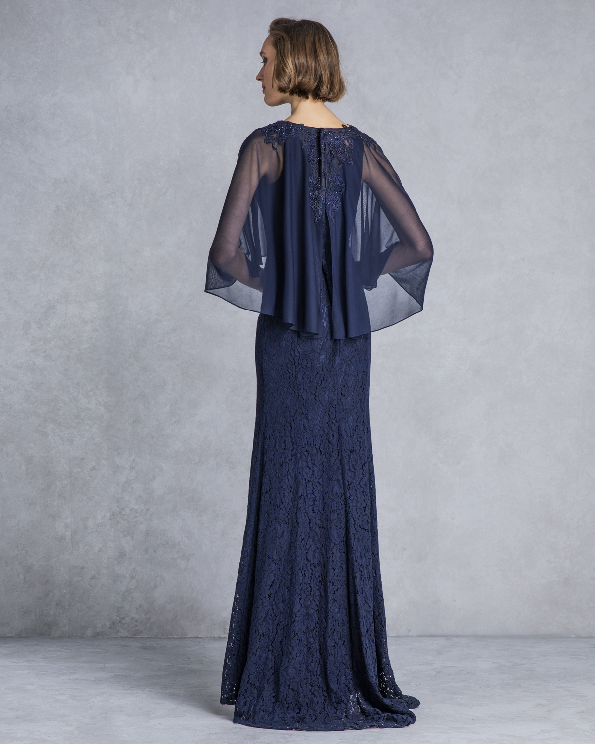 Classic Dresses / Long evening dress with lace skirt and cape