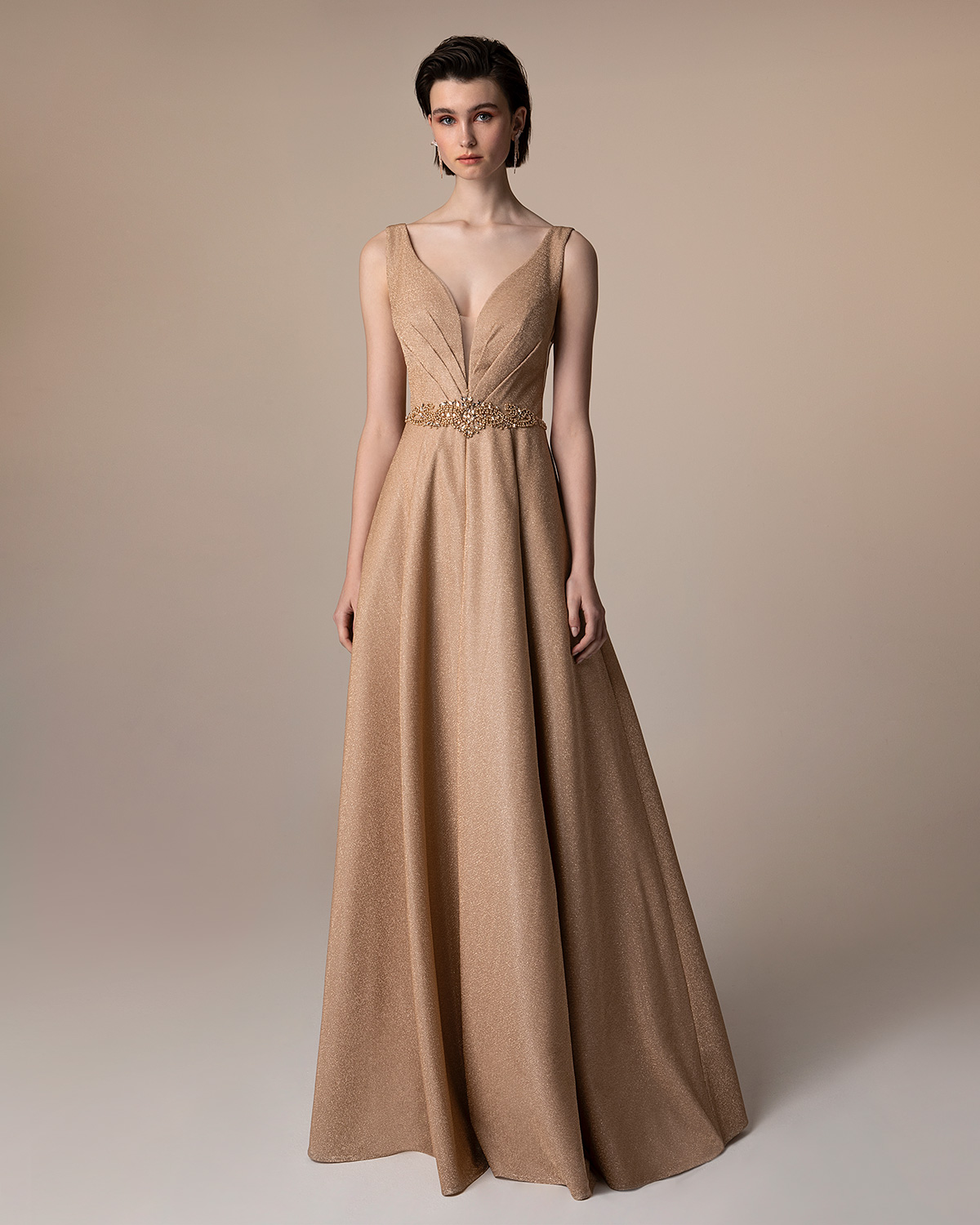 Evening Dresses / Long evening dress with shining fabric and beaded waist