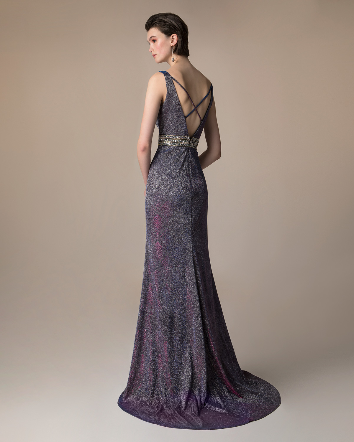 Evening Dresses / Long evening beaded dress with shining fabric and beaded waist