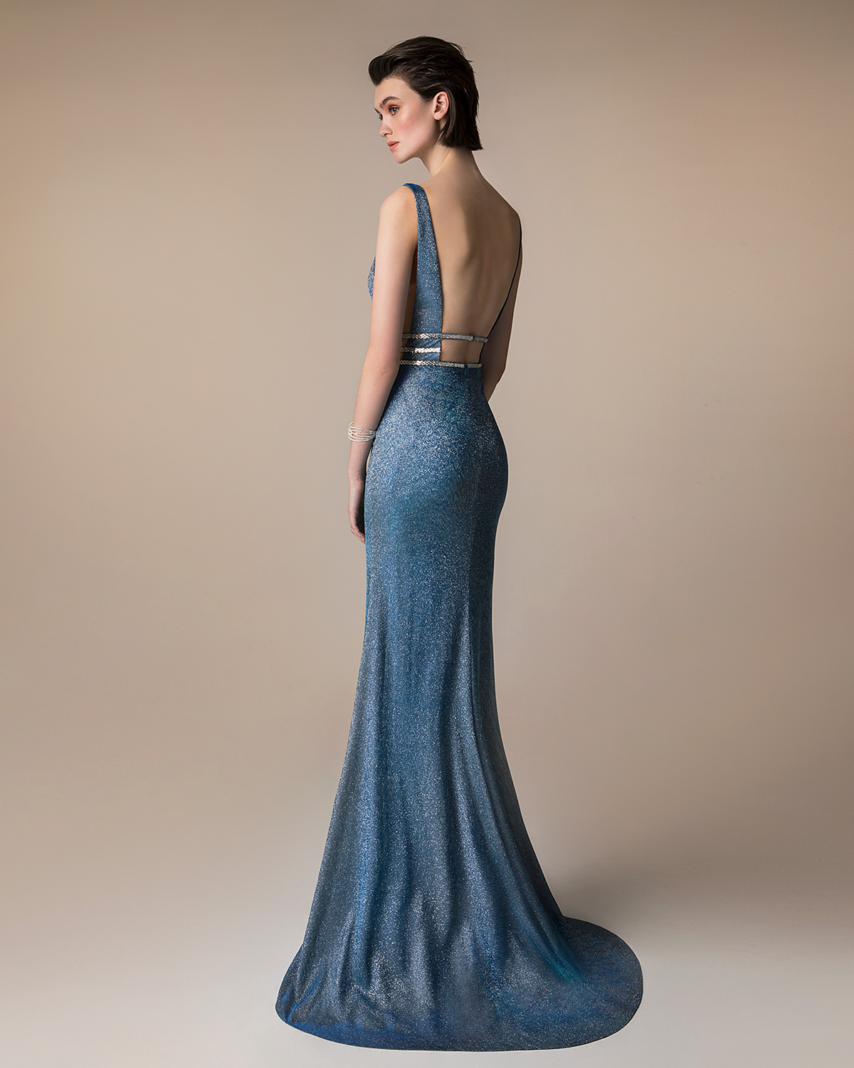 Evening Dresses / Long evening  dress with shining fabric,  beaded waist and open back