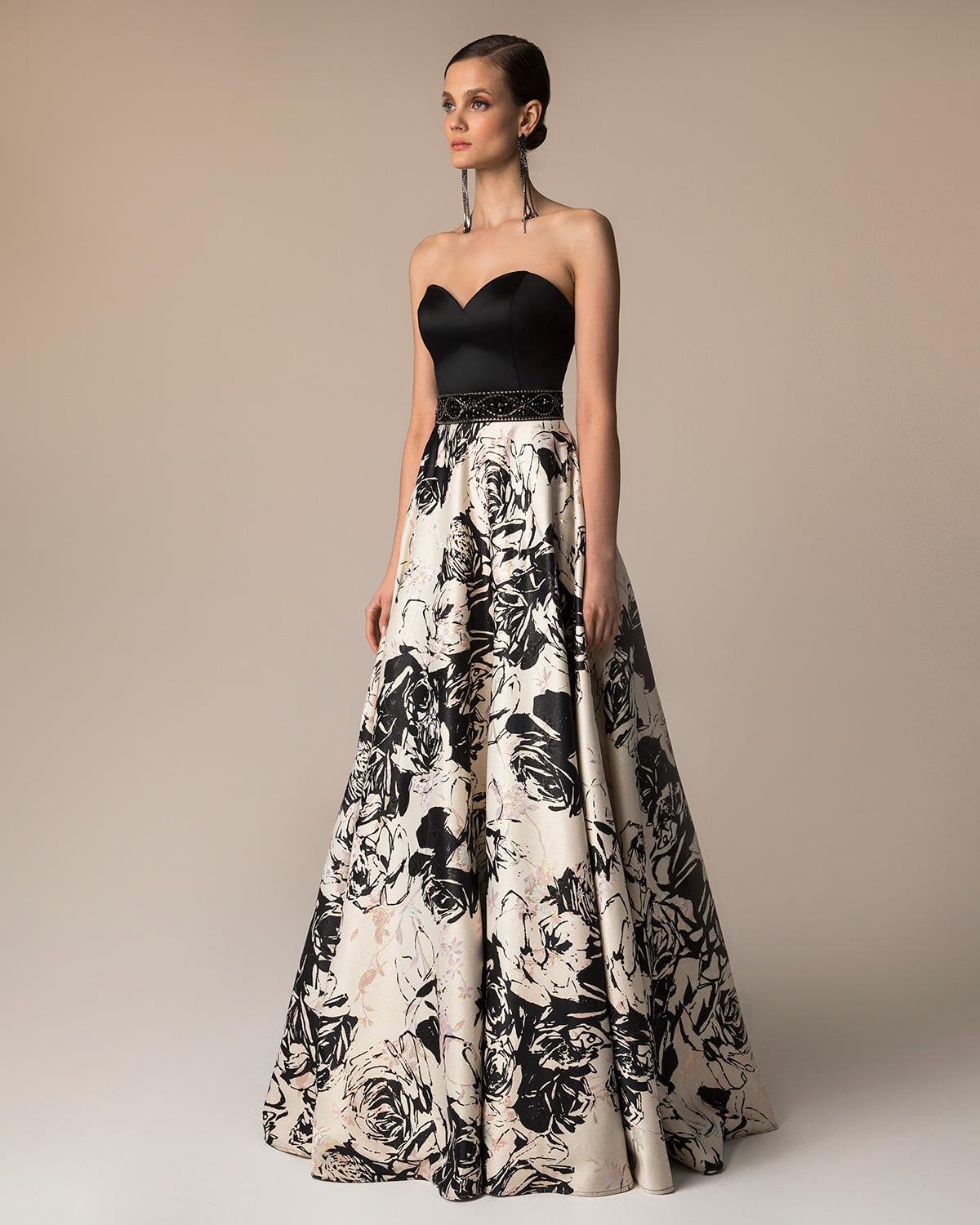 Long evening printed dress with beading around the waist