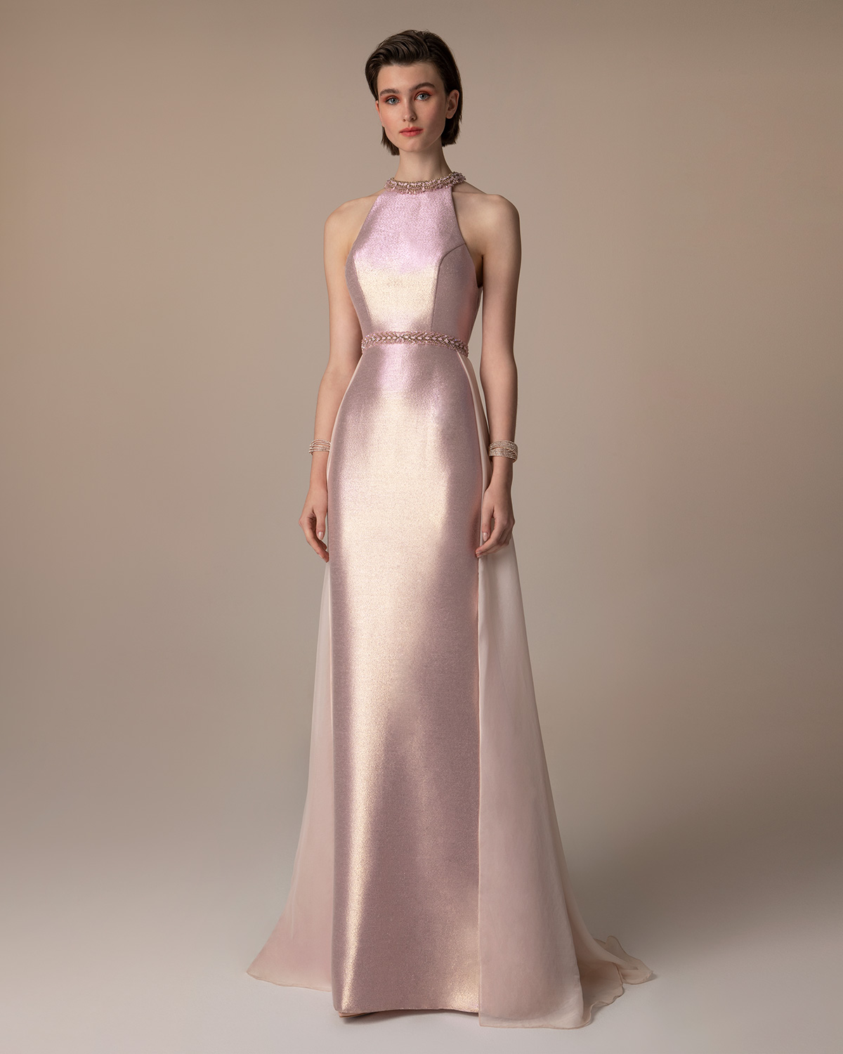 Evening Dresses / Long evening dress with shining fabric and beading on the neck and the waist