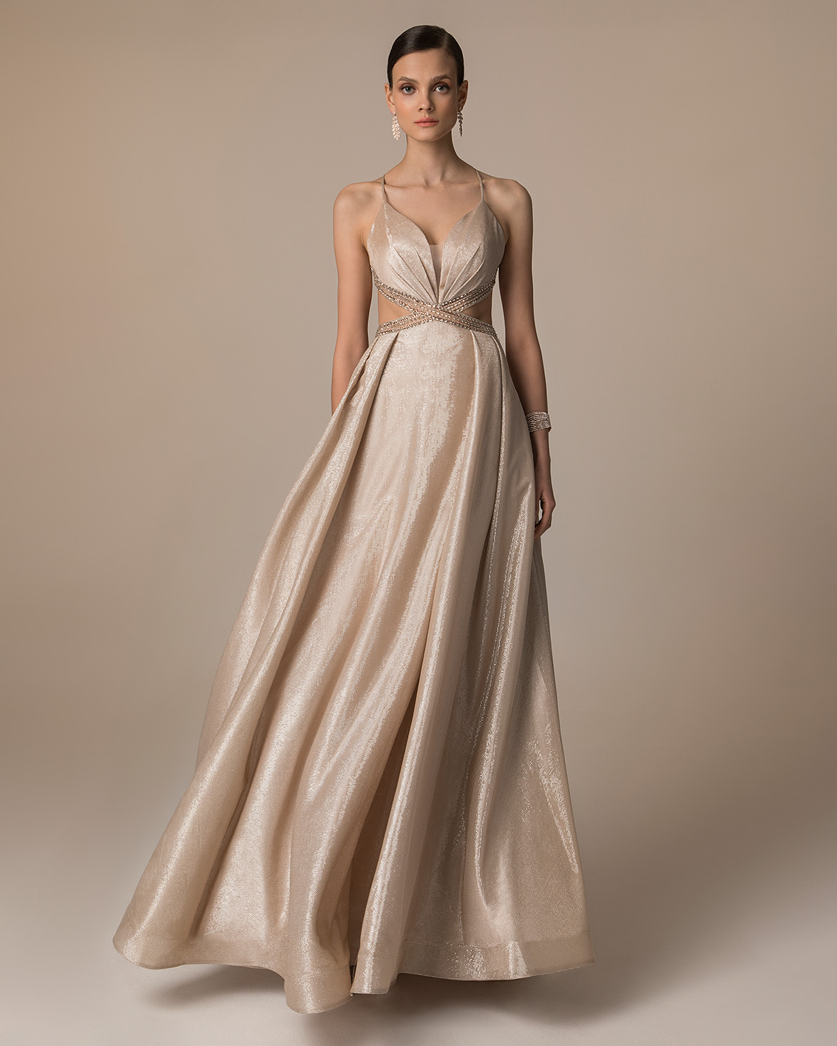 Evening Dresses / Long evening dress with shining fabric and beaded top and straps
